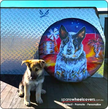 Spare wheel cover design with cute puppy sitting next to it on ute.