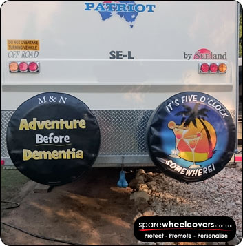 Dual spare wheel covers on a caravan