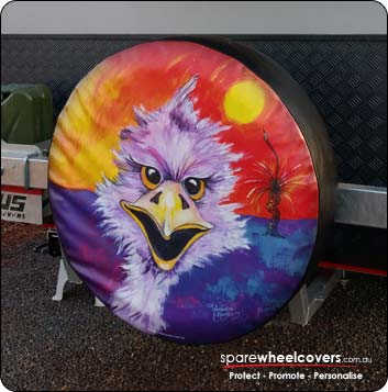 Colourful painting of outback emu on caravan spare wheel cover.