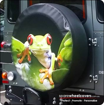 Green tree frog on spare wheel cover.