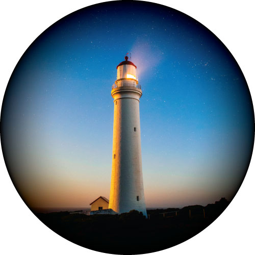 Lighthouse with a beautiful glowing blue sky printed on your spare tyre cover.